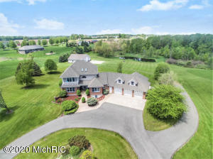 One of the few homes in this exclusive neighborhood that includes lake frontage.  Nearly 5000 square feet of living space, 4 stall garage, huge 50x48 pole barn on 5 acres with 50' of private, sandy frontage on all-sports Duncan Lake.  Just 11 miles to the Airport and less than 20 miles to downtown Grand Rapids, make this your primary home and lake home in one!  The large and functional eat-in kitchen features custom hickory cabinets and stainless steel appliances with bar and desk area.  A large master suite includes a private balcony and beautifully updated bath with custom tile shower and huge walk-in closet. Walk-out lower level is set up for entertaining with wet bar, pool table and 120'' home theatre. All new LVT flooring and new carpet on the main floor, staircase and upstairs office as well as fresh paint throughout the home. Possession is 45 DAC.