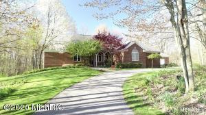 Located in the desirable Rockford School District, this classic ranch style home offers great privacy on a wooded 1.47-acre parcel in Egypt Valley View, a great 10-home community serviced by a single cul-de-sac street. There is also an adjacent 4-acre wooded common area which is a great added buffer for your privacy and enjoyment. The home has an amazing deck that ties in the outbuilding and entire back yard, which comes complete with a putting greenand great firepit for those soon-arriving summer evening bonfires. Need a little extra space, she-shed or mancave?... then be sure to check out the matching 2-level accessory building with both interior stairs and lower level entry. This one-owner home offers 5 bedrooms, 3 full and 2 half baths and 2,478 sq. ft. on the main level and over 4,300 sq. ft. of total finished living area. The well-appointed kitchen has a pantry, center island with butcher block top and snack bar, and beautiful cherry cabinetry. Hardwood flooring throughout high-traffic areas. There is also a dining room with deck access, living room with vaulted ceilings, recessed lighting and a gas fireplace. Formal dining room, office and main level laundry. The master suite has a walk-in closet, private bath and 2-person jetted tub. There is one additional bedroom on the main level along with an additional 1+ baths. The walkout lower level has a great family room with the country club vibe going, a rec room / flex area, and kitchenette with wet-bar. There are also 2 additional bedrooms and 1+ baths on the lower level. The many extras in this home include cedar lined closet, underground sprinkling, water softener, being wired for a whole house generator (self-maintaining generator is negotiable) and so much more. Virtual showings available!