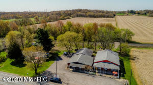 Aerial view of 2 bedroom home, 42.5 acres, market and barns