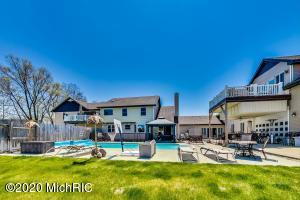 Oasis awaits with heated pool, hot tub and patio area.