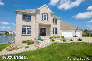 Click the 3D Tour Link. Enjoy 165' of sandy beach on K Lake w/4 lit fountains and ideal for swimming, paddle boat, kayaking & ice skating. Main floor offers 2 story foyer, great room w/FP, formal dining room, kitchen w/eating area, snack bar and new granite counter tops, MFU, office or den, elevator to lower level. Upper: 4 bedrooms, full bath, private master suite w/walk in closet & new DELUXE private bath. Lower: finished walk out level, family room/rec room combo, private in law suite (heated w/in ground radiant heat) full kitchen, dining area, bedroom, bath, private walk out to patio. Enjoy lovely landscaping, fruit trees, & garden areas. Thousands spent in fine upgrades throughout. Barrier free $100k deluxe in law suite addition w/elevator. See supplement for more info. Call today Unique opportunity. Seller has spent thousands in fine upgrades. There is also a barrier free $100k deluxe in law suite addition w/elevator. Enjoy 165' of sandy beach on K Lake w/4 lit fountains and ideal for swimming, paddleboat, kayaking & ice skating. Main floor offers 2 story foyer, great room w/FP, formal dining room, kitchen w/eating area, snack bar and new granite counter tops, MFU, office or den, elevator to lower level. Upper: 4 bedrooms, full bath, private master suite w/walk in closet & new DELUXE private bath. Lower: finished walk out level, family room/rec room combo, private in law suite (heated w/in ground radiant heating) full kitchen, dining area, bedroom, bath, private walk out to patio. Enjoy lovely fruit trees, garden areas & so much more.Gorgeous views from almost every room. Lovely area, friendly neighbors. Just steps from Kent Trails, Metro Hospital, Rivertown Crossings Mall and all modern conveniences. Brand new roof 2018, Appliances 2016, alarm system 2018, water heater 2016, hot tub 2018 (negotiable) Furnace 2017 See attachment for additional list of upgrades. Seller has recently had main floor, 2 story foyer, bedroom and upper hall professionally painted (no