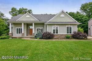 PRICED REDUCED from $459,900 to $429,900.  Brand NEW A/C unit just installed. This large executive ranch home is situated on a beautiful wooded lot and quiet street. Home has 12' & 9' ceilings, custom cabinets and 2 gas fireplaces. Master suite is conveniently located on the main floor. Large deck off the main floor and a patio off the walkout lower level to a gorgeous back yard. The finished lower level offers 2 bedrooms, a full bath, family room, game room, theater room, plenty of space for your storage needs and is plumbed for your future wet/snack bar area.