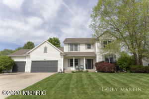 This meticulously maintained 5-bedroom home shines like new both inside and out! Step inside and the foyer leads you to the large living room that includes a gas fireplace and large windows that let the outside in. The kitchen and dining area are open to each other, creating a perfect spot for entertaining. Glass sliders take you to the deck that overlooks the park-like backyard which includes a half-sized basketball court. There are 4 bedrooms on the upper bedroom with two full bathrooms, including the private bath off the owner's suite. The finished daylight lower level includes an additional bathroom, bedroom, and living are - not to mention the utility room and storage. The package is made complete with a 3-stall attached garage. Schedule your private & safe showing today!