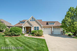 As summer approaches, you will appreciate waterfront living at it's finest, in this stunning home with top-to-bottom custom upgrades located within the desirable and upscale Hager Park West. Meticulously maintained inside and out, this 4 bed, 3 bath, 3500 sq. foot finished executive walk-out ranch home will have you putting your feet in the sand and appreciating all the grandeur this home has to offer.  The exterior features an inviting and expansive front porch surrounded by mature no-expense spared professional landscaping, including custom stamped concrete edging and underground sprinkling.   Casual elegance abounds in this home, featuring 10' tray ceilings in the living and 9' throughout, all with fresh paint.  The open concept main floor features brand new on-trend Luxury Vinyl Plank. Year-round you'll love the gorgeous stone gas-log fireplace in the open-concept living and dining.  The chef's kitchen features beautiful soaring cabinetry with plenty of storage, high-end rose gold appliances, new faucet, granite countertops and stone backsplash.  Directly off the kitchen, you will be wowed with expansive water views at every angle from your light-filled sunroom.  Enjoy sipping wine and coffee taking in the gorgeous waterfall and water views from your covered composite deck. The well appointed double-door entry main-floor master bedroom has the finishes you would expect from a home of this caliber including a spacious on-suite bath with custom tiled shower, jetted tub, water closet, and heated floors.  A dream main-floor laundry room, a grand bedroom and spacious bath round off the main living area.  Wake up refreshed with custom black-out blinds in every bedroom.  The huge finished lower level includes 2 bedrooms, full bath, and craft room/office plus a large area for storage. Wired for hot tub and generator.  Garage has built-in shed on upper and lower levels, perfect for storing all your outdoor and water toys. The moment you step down to the lake you'll be de