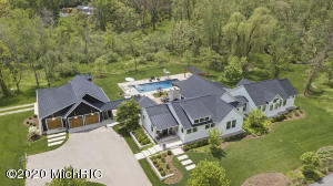 """Start with the picturesque, private 3.57 acre, carefully landscaped, site with over 650' of meandering Honey Creek frontage, add in a gorgeous example of Modern Farmhouse Architecture, finished with over-the-top material use and hand crafted build-quality by acclaimed commercial builder Dan Vos Construction. The result is a very special, resort-like property in a quiet country setting and still close to the new Ada Village. While the original house started in 2002, it was significantly added onto and completely remodeled into a 4,248 square foot masterpiece with high-end finishes in 2014. In 2017, the owner completed exterior additions including a 5-star hotel-quality entertainment mecca with a 20' x 48' concrete, mineral pool, built-in spa, changing room, outdoor shower, multiple lounge areas including a huge covered outdoor family room with bar, outdoor fireplace area, plus separate covered poolside lounge area. Seller also expanded the garage into a 2,232 square feet, 5+ stall garage plus a 500 square foot loft storage area. Opportunities like this seldom present in the market. See extensive media and attached """"Features"""" sheet to experience all the special amenities."""