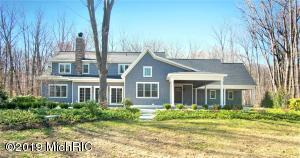 Enjoy this stunning custom build home while enjoying being a part of the historic and active Castle Park Community. Association has deeded beach access, tennis courts, pool, amphitheater, and frequent social gatherings. Open concept home with Provenza hardwood floors throughout. Kitchen has top of the line Thermador appliances and ample Woodways cabinets. Four-season porch offers a fireplace and beautiful views of the property. Main floor master has a walk-in closet, bathroom with two vanities and oversized walk-in shower. Back hall has storage, powder bath, and laundry. Upstairs has two more bedrooms with attached bathrooms, an office and bonus room that could be finished as another bedroom. Outside has a large patio, perfect for entertaining with a gas fire pit surrounded by nature views
