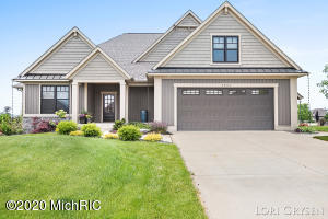 Welcome to 5833 Nelson Drive.  With quality construction and upgrades galore you will find this a most welcoming home!   The gourmet kitchen complete with top of the line appliances, huge island and walk in pantry is a entertainer's dream!  A luxurious master suite complete with a beautiful walk in shower and soaker tub.  Enjoy the waterfront views from the dining room, living room and master suite.  A lovely covered deck is the perfect place to relax and enjoy the sunset!  A second bedroom or office, full bath, laundry and mudroom round off the main floor.  Don't forget about a the spacious bedroom and full bath in the upper level bonus space.  The lower level has tons of potential with a walkout and room for another bedroom, bath, and rec room. 10 foot ceilings and roughed in for in floor heat (boiler not installed) will make this space just as beautiful as the rest of the home!  No lack of garage space with the upper garage (2.5 stalls) and lower garage (3 stall space).  Enjoy the beautiful Georgetown shores with lake access included in the association and right around the corner.