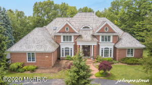 One owner, all brick home situated in popular Flowers Crossing Neighborhood. Custom built by BDR, Designed by Jeff Visser. 2 story family room w/ Fireplace & Built ins. High end finishes & custom millwork. Wood paneled Office. Formal Dining Room. Open Kitchen. 4 Season Room w/cathedral ceiling & wainscoting. Large Laundry with 2 sets of washers/dryers. Main Floor Master Suite w/ trey ceiling & WIC. Mudroom w/ boot bench & lockers. Upper level includes 3 bedrooms w/ built in desks & 2 baths. Lower level features open Family room w/Fireplace, Bedroom, Bath, Exercise room, & Full Kitchen. Zoned heat. 3 Furnaces. Private backyard w/ living spaces overlooking natural preserve. New wood shingle roof. Gated community w/sidewalks. Assoc. includes Park, Playground, Sports court, Pool & Poolhouse
