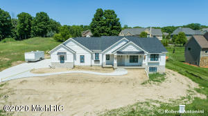 This is a great opportunity to own a NEW custom built home located in one of the most desired locations within Georgetown Township. This highly detailed and spacious home is not your typical 'spec-home', it is in the well-established neighborhood of Summerset West and boasts 9ft fully smooth finished ceilings throughout. There are 3 bedrooms and 2.5 baths on the main level. This home boasts premium grade Anderson windows throughout.  No expense was spared by this custom home builder with 50+ years of experience in building a solid, quiet, strong, & long lasting low-maintenance residence.  An OVER-Sized side-entry 3-stall garage complete with floor drains and full width 18' W x 7' H door, plus an additional 10' W x 9' H door will accommodate larger vehicles or a boat.The kitchen boasts an open floor plan with an extra-large island for entertaining.  Beautiful solid hardwood cabinets featuring both transom and full height doors, a coffee bar/drink station, wine rack, glass cabinet doors, decorative/book shelving, top tier quartz countertops, custom crown moldings, & commercial grade fully waterproof flooring (including a thick rubber backer for quiet walking) round out the kitchen features.  The attached dining area shows beautifully with a ship lap tray ceiling, crown molding, hanging light fixture, and enough room to accommodate a 10ft long dining table with six to eight guests comfortably.  Step through the 8ft wide slider door to the maintenance free outdoor patio, no deck to have to maintain! The adjoining living room includes a full height picture window, gas fireplace with custom stained hardwood mantle, ship lap, stonework, built-in cabinets, electronics wire chases, and option to mount a television both above or alongside of fireplace. The Master suite is large enough to comfortably accommodate a king-sized bed along with several pieces of bedroom furniture and has conveniently located light and fan control switches right by the bedside. The master bath inclu