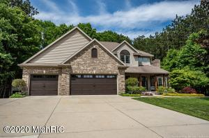 An immaculate 5 bedroom, 3.5 bath home located at the end of a quiet cul de sac in Hudsonville schools. Recently renovated in 2017, this home features a large kitchen with an island, quartz countertops, thermador appliances, LVP flooring, pantry, under cabinet lighting, and counter top gas stove. The two-story, all stone fireplace in the living room is sure to make you feel warm and cozy in the winter months. A large main-floor master suite has a double vanity, walk-in closet, whirlpool tub, and glass shower. The basement features a rustic style family and bar room with a kitchenette that contains granite counters, a mini fridge, sink, and included TV. Outside you will find a 2.5 stall, two-story pole barn with plenty of room for your trailer, lawn mower, work room, and other toys!