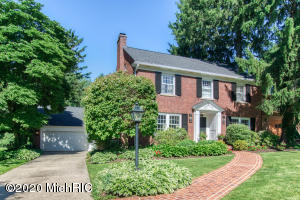 Stately all-brick home on a mature .362 acre park like backyard w/patio & professionally landscaped grounds. Meticulously maintained & updated throughout. Large windows, gracious room sizes, 2 fireplaces, custom builtins, polished hardwood floors & open floor plan perfect for everyday living & entertaining. Main floor features dining room w/bay window, wood paneled den, formal living room, large gourmet kitchen w/island ,dining, pantry, builtin wet bar & desk. The 3 stall tandem attached garage leads into the mudroom & 1/2 bath. Upstairs, master suite w/lg walkin closet & tiled bath w/his & her sinks & heated floors. 3 bedrooms/1.5 baths & a 3rd floor (unfinished) w/cedar closet complete the upstairs. Lower level has a large family room with wet bar, half bath, laundry & tons of storage. A finished basement with family room &  ½ bath are just more noteworthy aspects of this EGR beauty. Additional amenities - glimmering hardwood floors, 6 panel doors, 3 stall attached tandom garage, new carpet in basement 2019, built-ins galore, ample storage, UGS, 2 furnaces, 2 A/C units, 2 ovens, security system, surround system in every room, walk-up unfinished 3rd floor attic w/cedar closet.