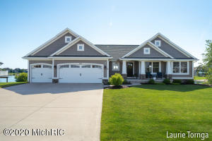 Don't miss this stunning and impeccably kept custom built lakefront home on Victory Lake in the desirable Georgetown Shores area. This beautiful 4-bedroom ranch is completely turn key and move in ready! The main level features an open concept kitchen with stainless steel appliances, dining area, living room with cathedral ceiling and gas fireplace, main floor mud room with washer and dryer hook up, a master suite with gorgeous trey ceiling, 2 additional bedrooms and another bath and a half. Hardwood floors sprawl throughout the main level. The custom finished downstairs is an entertainer's dream with an oversized rec area-family room, large wet bar, 3rd full bath, 4th bedroom, spacious laundry room and plenty of additional storage.  Outside you will enjoy your oversized upper deck, 100 ft of water frontage, a beautifully maintained beach, dock, backyard basketball court, landscaping, and underground sprinkling. A true turn key ready home with a great floor plan. Call for your private showing today!