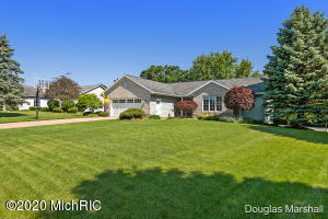 This beautiful walkout ranch located in Georgetown twp has 4 bedrooms and 2 1/2 baths. Built in 1996 and only one owner This home has everything and more you are looking for. Currently the home backs up to 87 acres of the future site of Grand River Greenways Bend area Green Space. You will find an open concept main floor layout with sunroom with gas fireplace. Main floor laundry, master bedroom with ensuite, quartz counters in kitchen and corian in bathrooms. The house has a central vacuum system, wall speaker system, wifi thermostat, seven zone sprinkler system, culligan reverse osmosis water system, newer stainless steel appliance. The walk out basement has 2 bedrooms and full bath. There is a beautiful screened in porch and covered patio along with a firepit. You wont want to miss this!