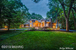 Recent appraisal has valued this waterfront retreat at $1,850,000! Phenomenal value, rare find, and noteworthy 7,609 SF 6-bedroom 5 full bath masterpiece completely renovated with timeless architectural elements inspired by designer Rock Kauffman nestled on 451 feet of prime frontage on Thornapple River! Enjoy your very own ''Lakehouse'' in this intimate 1.7 acre setting with unrivaled privacy with outdoor entertaining oasis, lavished professional landscaping, private boat launch and private dock all wrapped w/picturesque 180-degree views of the waterfront! Exceptional entertaining with open concept throughout, 2 gracious living areas, 4 fireplaces, massive office with palatial ceilings and windows, and stunning formal dining. Kitchen features new floor to ceiling windows with gorgeous riverfront views, new stainless appliances, hardwood floors, granite counters, with elevated island, all wrapped with custom cabinetry. Second level features private master with trey ceiling, custom built ins, cozy fireplace, breathtaking views of the waterfront, new engineered flooring, new windows, phenomenal dressing area, and pamper plus master bath. Two gracious bedrooms and beautifully renovated full bath complete the second floor. Lower level walkout features a great entertaining area wrapped with new windows, new carpet, new kitchenette w/built in refrigerator & Bosch dishwasher, majestic fireplace, 3 additional bedrooms, 2 full baths w/custom tile elements, cedar closet, new work out facility, ample storage with custom shelving! Expansive laundry makes for an amazing craft area, newly renovated mud room, efficient multi-zone heating system, new well pump, new reverse Osmosis system, two new hot H2O heaters, expansive 3 garage (w-new/epoxy floors and new garage doors +openers), newly resurfaced drive, built in basketball with netting. You'll never want to leave home in your very own 14' x 14' personal boat house completely secluded with phenomenal views. 4th car garage is perf