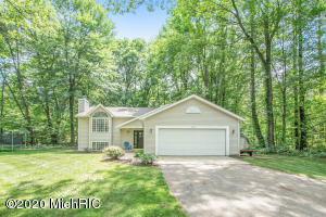 Are you looking for that perfect turnkey house? This completely remodeled 4 bedrooms 2 full bath house is sprawled out on over an acre parcel in the Grandville School District. Upon entry, you will be embraced with a mature wooded yard that is ideal for entertainment and endless activities. Continuing into the home you will find custom built-ins, new engineered wood flooring, fresh paint, and new trim throughout, the fully remodeled kitchen is equipped with new custom cabinets, quartz countertops, tiled backsplash, and new appliances, which stay with the home. The main floor has an open concept accompanied by vaulted ceilings and an inviting stone gas fireplace which creates the most wonderful ambiance. Each level has 2 bedrooms and a full bathroom completed with granite countertops and LVP flooring. This turnkey house truly is a must-see! All offer due Sunday, June 28th at 5:00 PM. Note* The deck is contracted for staining this week. Open is scheduled for Saturday, Jume 27 from 1-3 PM.