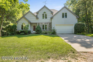 OFFERS DUE 6/30 at 6:00pm! First time on the market, located in Zeeland schools. This home features vaulted ceilings for a grand feel. The kitchen is equipped with custom-built oak cabinetry, granite countertops, and stainless steel appliances.  On the main floor, you will find the master suite with a tile shower and jacuzzi tub, formal laundry room, and half bath. Upstairs, the home has three large bedrooms (two of them having walk-in closets), a full bath, and a loft area that makes a great office or playroom space. In the daylight basement, you will find a very large finished rec room, and large finished flex space that could be used as a fifth bedroom. There are also two large unfinished storage rooms. The home sits on 5.5 beautifully wooded acres and is placed off the road for enhanced privacy. There is also a 30x45 pole barn that has power, its own well, and a brand new roof.Other recent updated include the air conditioning, well pump, pressure tank, and sump pump.