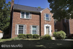 Solid brick 2 story home with modern flair! Enter to see classic tile flooring transitioning to hardwood throughout main level. Living room features cozy fireplace and ample seating area leading to dining area and out to 3 season porch. Galley style kitchen with breakfast nook aside pantry storage and half bath. Upstairs features 3 bedrooms and full bath (beds 2 & 3 not shown in photos) Basement has separate entry door and features updated furnace, laundry area, and potential for a home business. Minutes from downtown Grand Rapids and short bicycle ride to riverside park. Showings to begin Saturday!