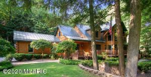 STUNNING LOG HOME IN SOUGHT AFTER CRYSTAL BAY WOODS NEIGHBORHOOD.  Enjoy the best of both worlds; Spring Lake water access, your own private dock to store your boat and beautifully wooded 1.4 acre lot.  The main floor features a 360 degree stone fireplace, soaring two-story ceilings and picture windows. The kitchen has a large center island w/granite tops which is connected to the dining room w/sitting area, cozy living room, screened-in porch, 1/2 bath, laundry room, and drop-zone off garage. The spacious main-floor master has a whirlpool tub, custom tiled shower, and walk-in closet. Upstairs you'll find a kids play/study area sandwiched between two bedrooms and a large bonus room (12' x 12'). Downstairs you'll find the family room, exercise area, 4th bedroom & full bath. Plenty of storage in two unfinished areas as well. Outside the setting is surreal, you have mature trees, large lawn, 3-stall garage, room for detached garage,   and big driveway for guests, community boat slips just a hundred yards away. Live amongst the trees in this gorgeous home with your boat on Spring Lake and you'll feel like you're UP North without having to drive!