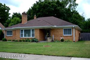 Beautiful brick 4 bedroom home in a desirable neighborhood. Features a 2 car garage, 3 season room, fireplace, beautiful wood throughout the home, formal dining room, newer kitchen. The 1/2 bath can be converted to a full bath with the removal of a closet.  Spacious rooms in over 1800 square feet. Huge attic storage space with easy ladder access. Garage has 2 stalls plus a workshop area.  Alger Heights/Garfield Park Area.