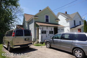 Large home in Grand Rapids featuring 5 bedrooms and 2 full baths. Sweat Equity opportunity. Seller has replaced roof, updated electric and plumbing, furnace with central air, water heater, most of the windows have been replaced but there is still work to be done. It needs new siding and  window trims. Seller is in the process of converting the garage to living area and needs to be finished.  Seller is selling in as is condition.  One block from Burton Elementary School. Close to 131 expressway. Buyer and Buyer agent responsible to verify all information with the City of Grand Rapids.