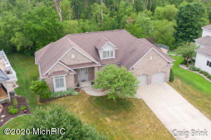 Beautiful executive home in coveted Greystone Estates in Zeeland. Enjoy your private backyard with a ravine & wildlife from many windows off the back of the home, sitting on the large deck or relaxing in the screened-in covered deck off master suite. Entertain family and friends on both the main and lower levels. Main level has 12' ceilings with spacious living room with gas fireplace, chef's delight kitchen with large island & double pantries, laundry room, master suite with big walk-in closet with organizers, dual sink granite vanity. Lower level features a family room with a 2nd kitchen, 3rd bedroom & bathroom plus 3 storage rooms one of which has a window & extra door. Extra deep 2-stall garage with extra storage for toys or workshop.