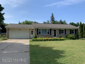 This Brick & Vinyl Ranch in Kentwood is extremely nice inside and out. It is on a quiet back street in a wonderful neighborhood and offers lots to enjoy including a huge privacy fenced backyard with a yard barn, a deck, and a 12x18 covered patio. It has newer replacement windows, central air, a 90%+ furnace, a 7-8 yr old roof, and beautiful hardwood floors. There is a big open living room and a 14x39 family room downstairs with a daylight window. That end could easily become a 4th legal bedroom and the lower-level half bath could be expanded into a full. There is a 2-stall attached garage, plenty of basement storage, lots of newer hardware and fixtures throughout, and the appliances all stay. This is just a beautiful home in a wonderful neighborhood and school district. Come take a look!