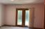 Main Floor Bedroom #2 has door leading to small deck