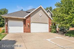 Come check out this BEAUTIFUL 2 story Grandville charmer! This home has so much curb appeal as you pull in the driveway and is located on a culdesac street! Main floor features a kitchen with plenty of cabinets and counter space, a large living area with gas fireplace, dining area, mudroom, laundry, and 1/2 bathroom. Upstairs you will find a master suite with private bathroom and walk in closet! Upstairs also features 3 more bedrooms and another full bathroom! Basement is finished with a great family/rec room with another gas fireplace as well as another bedroom and full bathroom with plenty of room left for storage! Step outside to a beautifully manicured yard with above ground, solar heated pool and deck perfect for entertaining! Hurry before it's gone!