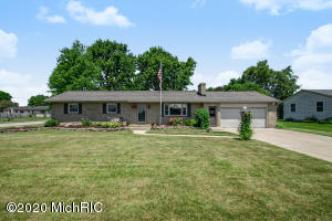 Welcome home to this beautiful brick ranch home in Kenowa Hills school district! Meticulously maintained with many recent updates. The spacious kitchen features tile floors, generous cupboard space, and a peninsula with seating. Walk from the dining area through the slider into a cozy three-season porch to enjoy a morning coffee or a late night drink while enjoying the beautiful yard. Living room showcases a fireplace and newer flooring. There are three bedrooms and two full baths on the main floor. Lower level has a bedroom that needs a few finishing touches. An attached two car garage helps keep you out of the elements. Many recent updates include; central AC, furnace, hot water heater, windows, vinyl floors, carpet in bedrooms, water softener, sump pump, well pressure tank and many more! Schedule your showing today!