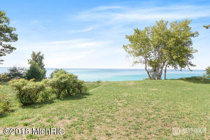Price & Compare  a Great Value on the  Shore of Lake Michigan.  100 ' Private Mid Bluff Frontage. Cottage is 3 Bedroom 2 bath plus a 1 bedroom guest house. Good sized out building for all the toys. Bluff is offered protection by concrete piers.