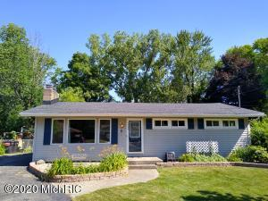 Nicely updated 4 bedroom 3 bathroom Ranch home in Kentwood Schools.  Freshly painted and looking sharp for the new owner.  You will like the kitchen, but you will love the master suite bathroom getaway!  Awesome back yard fire pit setup.  Fenced in back yard.