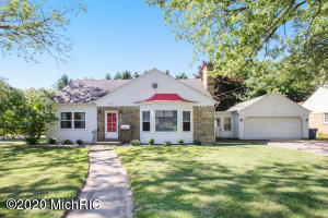 Alger Heights charmer! Plenty of space both inside and out. This beautiful property consists of 3 city lots, a rare find! On the main level you'll find a large living room with wood floors, kitchen and eating area, 2 bedrooms, a full bath, and an enclosed breezeway with attached 2 stall garage. Upstairs are 2 bedrooms with a Jack-n-Jill bathroom along with plenty of storage options. You'll also love the outdoor rooftop balcony! The walkout lower level consists of a finished family room, hobby room, along with a unique canning kitchen/laundry room and a half bath. Very close to Alger Park (with its new Splash Pad!), area schools, and also shops and eateries such as Real Food Cafe and The Old Goat. New hot water heater in 2015, new furnace and AC in 2016. Come see it now before it's gone!