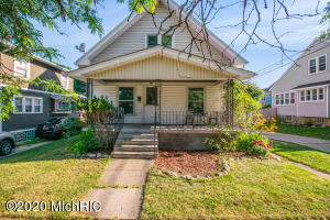 Welcome to 1017 11th St NW. This well-maintainted property is located right in the heart of all the new exciting opportunities the West Side of GR has to offer! The main floor has a large living room, dining room, kitchen with new flooring, main floor laundry, and a bedroom with access to the full bath. High ceilings and original woodwork bring out the old world charm. Original hardwood floors hiding under the freshly cleaned carpet. Upstairs you will find two generously sized bedrooms and a large unfinished room that could make a great 4th bedroom or additional bathroom!  Outside features a large front porch perfect for summer gatherings and detached garage. Short bike ride or walk to restaurants, entertainment, and Bridge Street corridor!! Don't miss out on this incredible opportunity!!