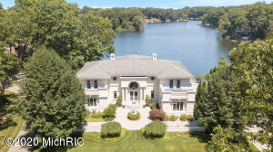 Once in a lifetime Mediterranean Masterpiece on a 1 acre lot with 164 ft of private waterfront frontage on all-sport Deans Lake in Grand Rapids that includes its own boat launch. This magnificent property was featured in the Grand Rapids Press as ''Dean Lake Mansion offers waterfront lifestyle''. The property, in the award winning Northview Public Schools, includes 4 bedrooms office, 4 full baths and 2 half baths, marble floors, grand staircase, soaring windows with gorgeous lake views, a fire place in both the master bedroom and living room, 4 balconies on the upper level and a large deck, granite kitchen with island, high-end appliances, 2 laundry rooms, master suite with soaking tub and dressing room, media room, central vac, walkout lower level ready to be finished the way you like and a dock/shore station are ready for your watercraft. There are many more things to list, yet the pictures speak a 1000 words. Call for a private showing today.