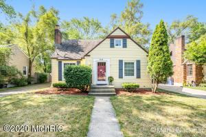 Cute move in ready Alger Heights Cape Cod home.  Walking distance to all that Alger Heights downtown has to offer including close to parks, schools and shopping. This home features 3 bedrooms with 2 on the main floor and  huge room upstairs. The Living room has a wood burning fireplace, the kitchen has a dining area included and a slider to back deck and fenced in back yard. The driveway is paved and includes a 1+ stall garage.  Come check out this darling home today.