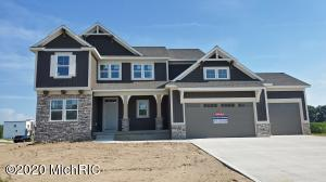 Beautiful ''Charlevoix'' plan by JTB Homes in desirable Railside Community in Byron Center. Open, spacious and well appointed home with custom trim-work and extra details. Huge corner lot with plenty of space to spread out. This plan features 4 bedrooms and 2 1/2 baths on the second floor, along with a luxurious master suite with ceramic tile shower, as well as an upstairs laundry. On the main floor you'll enjoy a huge kitchen with center isle, large pantry, tons of light, hard-surface floors throughout much of the main floor, and a first floor office/flex room. Enjoy the warm weather on your covered deck out back. PRICE NOW INCLUDES PROFESSIONAL LANDSCAPING and IRRIGATION!