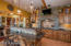 Center Island Snack Bar. All Hickory Cabinetry, Ambient lighting above cabinets