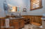 Main Floor 1/2 bath. Note Cabinet is made from Actual Barnwood from an Antique Barn