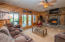 Lower Level Family Room w/Gas Fireplace, Slider Doors lead to the Covered Patio & Boulder Table Top