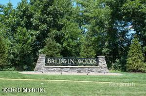 Like new condo in Baldwin Woods with a wonderful floor plan and 3000 square feet of finished space.  Beautiful open concept with large kitchen island, open living space overlooking the wooded ravine, large master suite, main floor office/flex room, and main floor laundry/mud room. You will love the covered porch off the main level that overlooks the ravine as well as a covered patio below.  In the walkout lower level you will find a huge family room, bedroom with walk in closet, large bath and a newly finished non-conforming bedroom or office.  This condo has quality throughout, come take a look for yourself!!