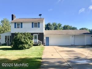 Potential abounds! This home is located minutes from I-96, Kenowa Hills high school,  middle school, and Alpine Avenue. This 3 bed, 1.5 half bath home offers city convenience with a country feel. You can enjoy summer days by the 20x40 in-ground heated pool with new pump and filter, dinner on the back deck, or winter nights by the gas fireplace. You will find hardwood floors in the living room, upstairs hall and each bedroom. This home also has a 3 car garage for plenty of storage. All appliances remain.