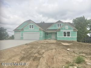 JTB Homes presents the ''Pentwater'' from their Landmark series. This home has it all! 3 stall garage, porch, 12x12 deck with stairs down to 12x12 patio. Inside you'll find a mudroom with bench, locker, and cubbies, and main floor laundry. Kitchen with walk-in pantry, center island with craftsman trim and solid surface counters. Cathedral ceilings throughout the kitchen, dining, and family room, and a gorgeous tiled fireplace in the family room. Main floor master suite with tray ceiling, large walk-in closet, and master bath with double sinks. The main floor also includes 2 additional bedrooms, an additional full bath, and a powder room. This home is currently estimated to be complete by mid-October. We encourage you to wear a mask and refrain from touching surfaces when touring the home