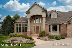 Executive Oasis Overlooking the 13th Green of Railside Golf Course. This spectacular location is nestled at the end of the cul-de-sac on a 1 acre lot that offers exclusive privacy, peaceful surroundings, and was strategically built to enhance interior living with Nature's Panoramic Beauty for a year round display of color and song.  Impeccable curb appeal beckons you to enter. Enter the two-story foyer to a fantastic floor plan and Brazilian Cherry Wood floors that sweep below your feet and million-dollar views everywhere you look. Built for entertaining in mind, whether for family, friends, or colleagues this home boasts upscale amenities with every step. (See More...)  The custom designed kitchen features extensive cherry cabinets, gourmet kitchen with island, pantries, snack bar and, granite countertops. All beautifully lit that sets the tone from dawn to dusk.  A comfortable eating area is only a step away and is set off by beautiful sliders that lead you to your own private 3 season room. A perfect space to sit down, relax, drink tea and watch nature's song in your own back yard. From Blue Herron, turkey, deer, great horned owls, to the song of a chickadee (see complete list attached). Nature is at your fingertip. There is then a grill deck area  to cook  up your favorite dishes.The Living room has a bank of East facing windows that fill the room with light, custom built ins and gorgeous brick gas fireplace.  There is a spacious formal dining room to accommodate any dinner party size, beautiful sitting room with 2 story ceilings and windows to match that is a great option for the perfect at home office.Around the corner you will find a main floor junior suite that is currently used as a private office, but is the perfect solution to accommodate guests for the evening, or perhaps when life changes and you  would like to have the option to take care of a family member.  This space can handle it all and is completed by a full bath, steam shower, walk in closet, an