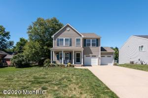 Don't miss this opportunity to live in a 4 bedroom,  3.5 bath home located within the Grandville School District. Situated in Rivertown Park, this beautiful home has so much to offer.  Featuring granite countertops, center island, large open concept with bonus room/office off the kitchen provides plenty of room to entertain.  On the upper level, the ammenities include large master bedroom with en suite and walk in closet, 2 additional bedrooms, laundry room and additional living space. Lower level includes storage, additional living room, bedroom with walk in closet and additional full bath. The backyard is treeelined with a paver patio and storage shed.  This energy efficient home also benefits from the Association with snowplowing, private 24 hr gym, tennis courts, and pool. Don't hesitate, and schedule your private showing today
