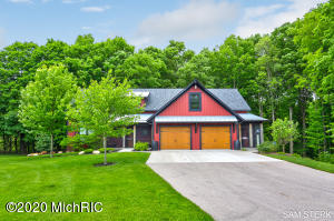 One of a kind home on a one of a kind setting.This custom-built home by Wagner Builders is in a class of its own. There is no detail missed when it comes to quality, design, functionality. From the moment you walk in you will be awed by the soaring ceilings, post and beam details, expanse of  windows overlooking the woods and ravine, exquisite master suite, massive custom built kitchen with a 10x124walk in pantry ( crazy big). All top of the line appliances with a standalone freezer and wine cooler, The upper level has a prefect desk/study area along with 2 bedrooms ( check out the built in bunks , wow) and full bath plus a large unfinished bonus area over the garage for much more potential. Oh, have I mentioned the amazing in-law apartment/2nd home down with its own 1.5 stall garage and   another custom-built kitchen? There is a patio door going out to a private oasis in the woods. If that is not enough there is an insulated 22x27 out building with a 6x27 porch area off the side.