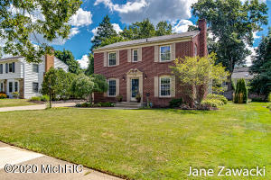 This pretty brick 2-story, steps from Lakeside Elementary checks all the boxes. Curb appeal is evident w/ professional landscape, including sprinkling & fencing, updated windows & gracious front entry. Spacious home with 5 BR & 3.5 baths gives everyone their own space but still offers generous gathering areas. The main level has a square kitchen w/ dining area, two flexible living spaces, two fireplaces, refinished hardwood flooring, powder bath & a step down to an entry off the attached double garage with extra storage. French door exits to large backyard w/ patio & gas fire pit, perfect for chilly fall nights outside. Upstairs you will find light filled bedrooms w/ good closet storage, & three full baths. The basement has a finished rec room & also has unfinished laundry & storage space.