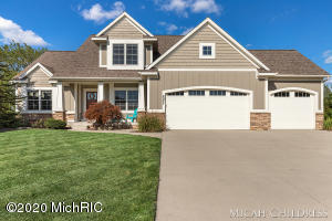 OPEN HOUSE SAT 1-3PM. This custom-built home in Hudsonville Schools sits at the end of a cul-de-sac. The open concept main floor features a large kitchen with custom cabinets, granite countertops, a double oven, a walk-in pantry, a spacious great room with fireplace, and a sitting room (could also be formal dining or home office). Main floor master suite has a jacuzzi tub, shower, walk-in closet, and double vanities. Upstairs has 2 bedrooms, full bath, and a loft perfect for playing, homework, or class Zooms. Walkout basement includes a theater, living room, bedroom, full bath, and two huge storage rooms. The large deck overlooks the private yard (go explore!). You'll be able to entertain, relax (hot tub!), or watch a game of hoops on the sport court. Park all your toys in the third stall!