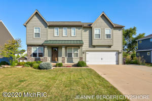 Completely finished and turn key home in the desirable Spring Meadows neighborhood in Jamestown Twp. The open concept main floor features brand new flooring throughout, living room with gas fireplace, sun room, mud room, walk in pantry, and a gorgeous kitchen with brand new subway tile and quartz countertops! The second level features 4 bedrooms, including the large master suite with walk in closet and walk in shower, a loft area, laundry room, and an additional full bathroom. The finished lower level has a very large family space, full bath, and 5th non conforming bedroom. Outside you'll find a composite deck, patio, underground sprinkling, professional landscaping, and a great size  yard. The association includes beautifully maintained park areas, community playground.