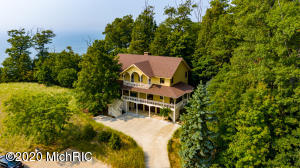 Holland's Southside custom built Lake Michigan home designed in the ''Old Macatawa Cottage'' style. Over 2,300 sq.ft of covered porches afford spectacular views, lake breezes and breathtaking sunsets! Large lakeside screened in porch for Summer dining and entertaining. Delightful rear patio too. Open concept family room with custom fireplace surround, dining room and well appointed kitchen with snack bar and center island. Four spacious bedrooms, three with covered porch access. Beautiful master suite with fireplace, private Lakeside porch and bath. Three stall garage has lots of storage. there is an outdoor shower and back up generator. This is the first time offered on the market and shows pride of ownership and has been lovingly cared for and maintained!