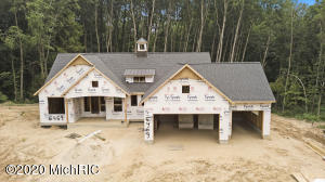 This designer walk out ranch presented by Schultz Builders features a private 3 acre wooded location with just under 2000 sq ft on the main floor designed with functionality with open concept floor plan providing a great gathering space, living room featuring fireplace with build ins on both sides. Kitchen encompasses large center island, solid surfaces, pantry, built in desk with large dinning area. Master suite is on opposite end of the other 2 main level bedrooms which gives option to use one as an office/den.  Walkout basement with 9 ft ceilings, amazing layout for entertaining with bar area, wine cellar. family room and gaming area. Two additional bedrooms/office or workout rooms complete this fully finish space. Will be completed beginning of NOV